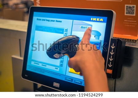 Gorizia, Italy, August 11, 2018: Ikea store, self-service scanner at the cash register, finger points to the price #1194524299