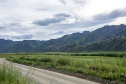 Gorny Altai, Russia. High mountains and dirt roads are the harsh beauty of nature.