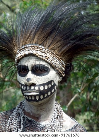 GOROKA,PAPUA, NEW GUINEA - SEPTEMBER 16: woman gets ready for the skeleton dance  at Goroka Tribal Festival  in Goroka, Papua New Guinea on September 16, 2011