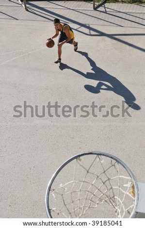 gorup of young boys who playing basketball outdoor on street with long shadows and bird view perspective #39185041