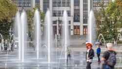 Gosprom building on the Freedom square with new dry fountain with people walking in park in Kharkov city timelapse, Ukraine