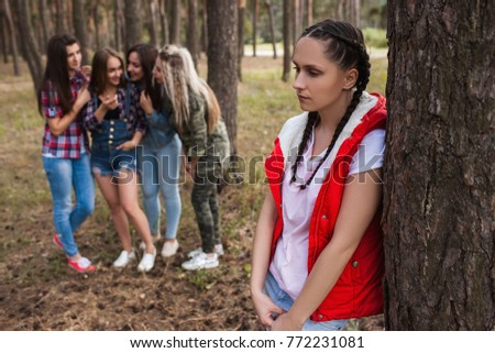 Gossip upset girl forest friendship strife concept. Female rivalry and discussion behind the back. Betrayal and sadness. #772231081