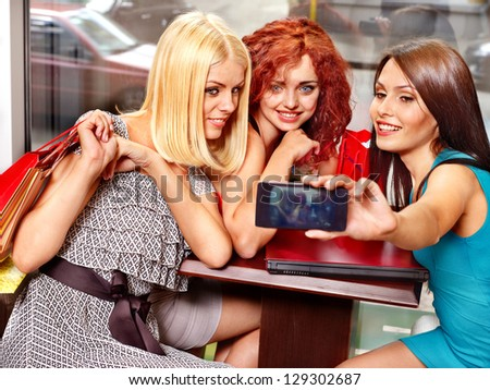 Gossip women with laptop in a cafe.