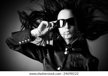 Goth woman with fluttering hair. Black and white concept.