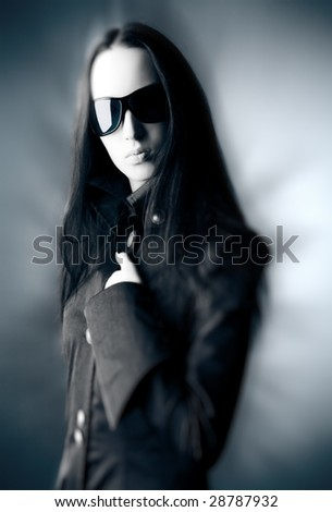 Goth woman with sunglasses. Selective focus effect.