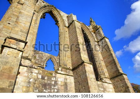 Gothic arches of historic Bolton Abbey in West Yorkshire, England.