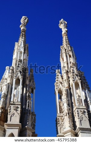 Gothic architecture details, blue sky background