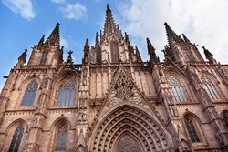 Gothic Catholic Cathedral Facade Steeples Barcelona Catalonia Spain.  Built in 1298.  This is the main spire.
