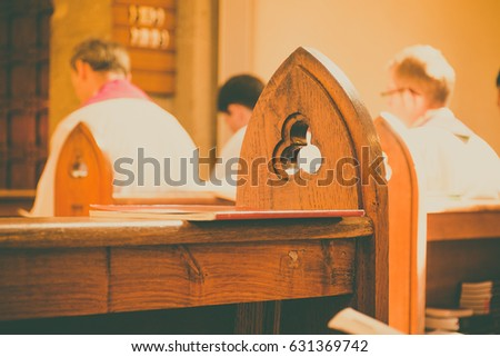 gothic church pews with priests ...