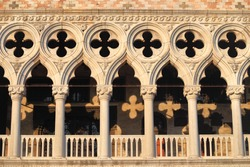 Gothic columns decorate the Doge's Palace (Palaz'zo Ducale) in Venice, Italy