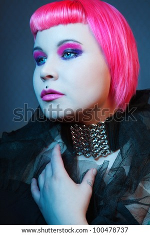 gothic girl with pink hair. studio