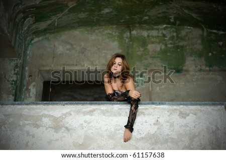 Gothic lady in abandoned building.