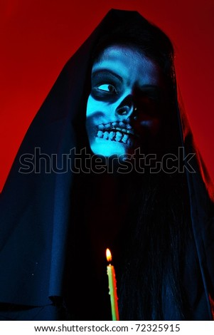 Gothic portrait of dead woman with candle