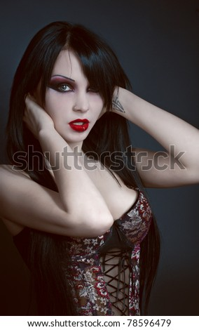Gothic studio portrait of brunette sexy woman