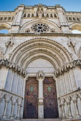 Gothic style door, arch and apse in the cathedral of Cuenca, Spain