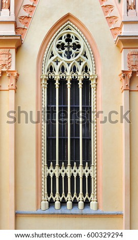 Gothic window of church with traceries, Italy