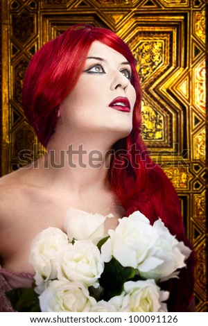 Gothic woman, faith concept. Red hair beautiful girl over  medieval gold background
