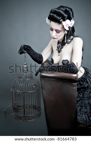 Gothic Woman with a empty birdcage