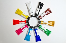 Gouache tubes set in a circular pattern. Arts, schools and education