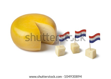 Gouda cheese with dutch flags on white background