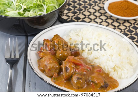 Goulash - Hungarian sausage stew served with white rice and green leaf salad.