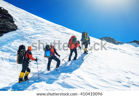 Shutterstock Goup of climbers reaching the simmit. Team work concept