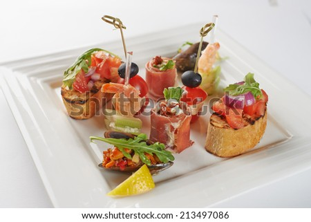 Gourmet Appetizing Variety Food on Square Plate, Isolated White Background