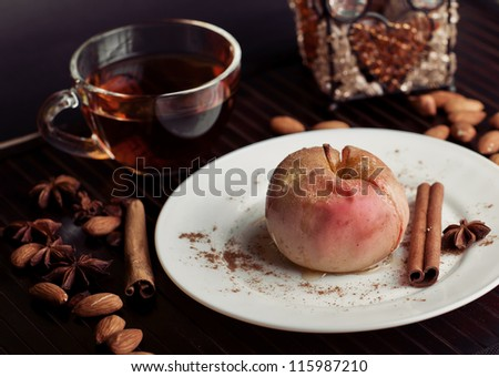 gourmet baked apple with tea and almonds