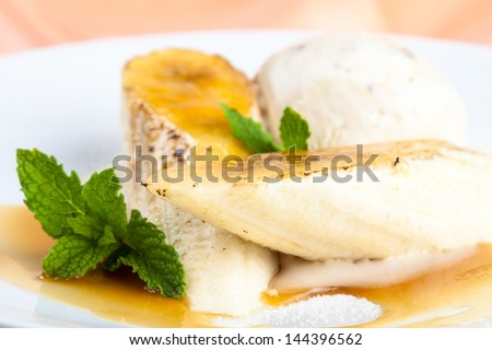 stock-photo-gourmet-banana-brulee-with-ice-cream-dessert-144396562.jpg