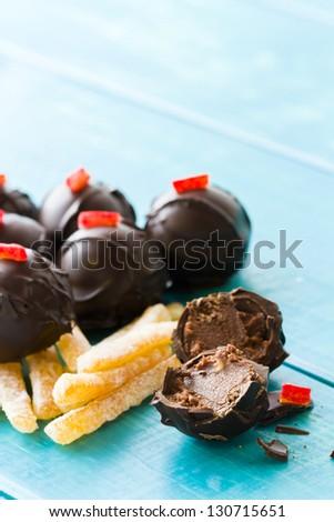 Gourmet blood orange truffles hand made by chocolatier. - stock photo