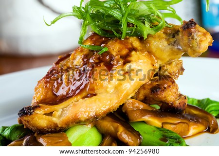 Gourmet bone in Chicken Cooked Asian Style.  Basted with a Teriyaki, soy glaze and garnished with green onions.