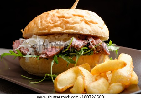 Gourmet burger with roast beef, potato and parmesan cheese, close up