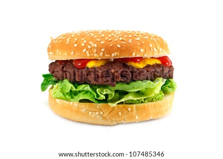 gourmet cheeseburger with a homemade beef patty on a bed of lettuce with ketchup