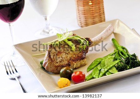 Gourmet dinner of veal rib chop and vegetables
