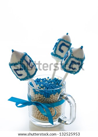 Gourmet dreidels decorated with white icing for Hanukkah.