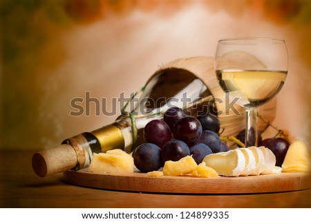 Gourmet food background, border with wine, cheese and grapes