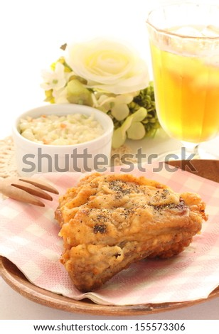 Gourmet food, fried chicken with iced drink and salad
