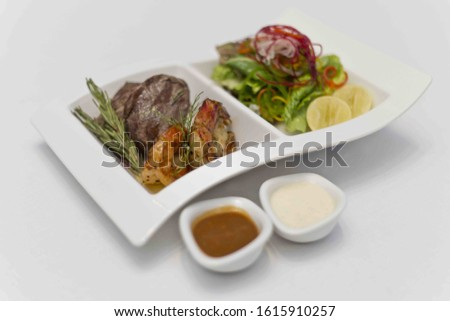 Gourmet food served on a white plate.