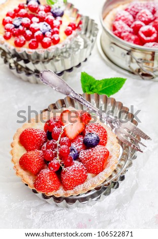 mixed berry tartlets on crisp golden pie crusts served in individual ...