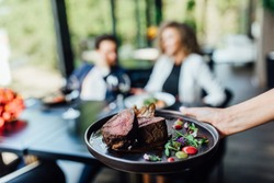 Gourmet grill restaurant steak menu - New York beef steak on wooden background. Black angus prime beef steak. Beef steak dinner.