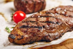 Gourmet Grill Restaurant Steak Menu - New York Beef Steak on Wooden Background. Black Angus Prime Beef Steak. Beef Steak Dinner