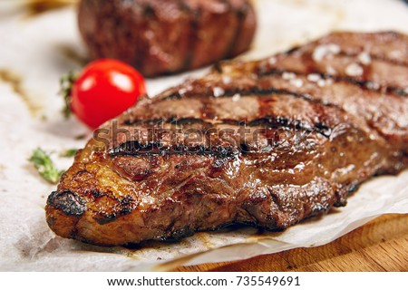 Gourmet Grill Restaurant Steak Menu - New York Beef Steak on Wooden Background. Black Angus Prime Beef Steak. Beef Steak Dinner