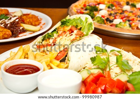 Gourmet kebab with a side of fries and dips