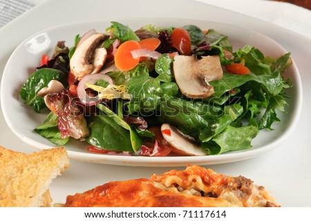 Gourmet Lasagna with chef salad and garlic toast