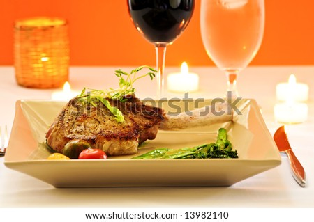Gourmet romantic dinner with red wine at candlelight