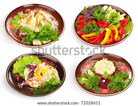 """Gourmet Russian herring salad (""""coated"""" ), sauerkraut, healthy salad with tomato, cucumber, pepper under cream sauce and pineapple flower on the top and healthy salad with tomato, cucumber, pepper. - stock photo"""