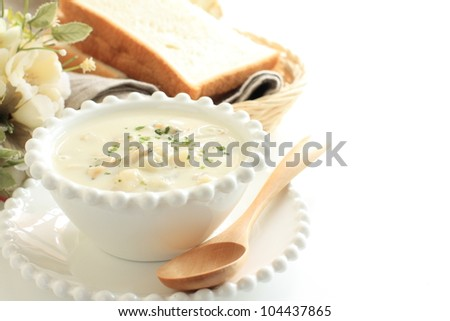 Gourmet soup, Clam chowder and bread - stock photo