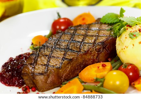 Gourmet Steak with Green Beans,Cherry Tomato,Cranberry - stock photo