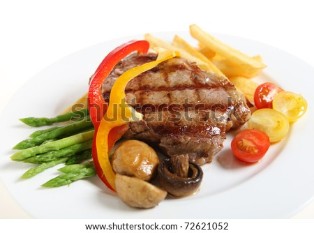 Gourmet style veal sirloin steak, served with asparagus, grilled mushrooms, cherry tomatoes, ribbons of red and yellow capsicum and fries.