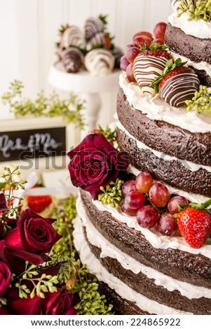Gourmet tiered wedding cake at wedding reception.